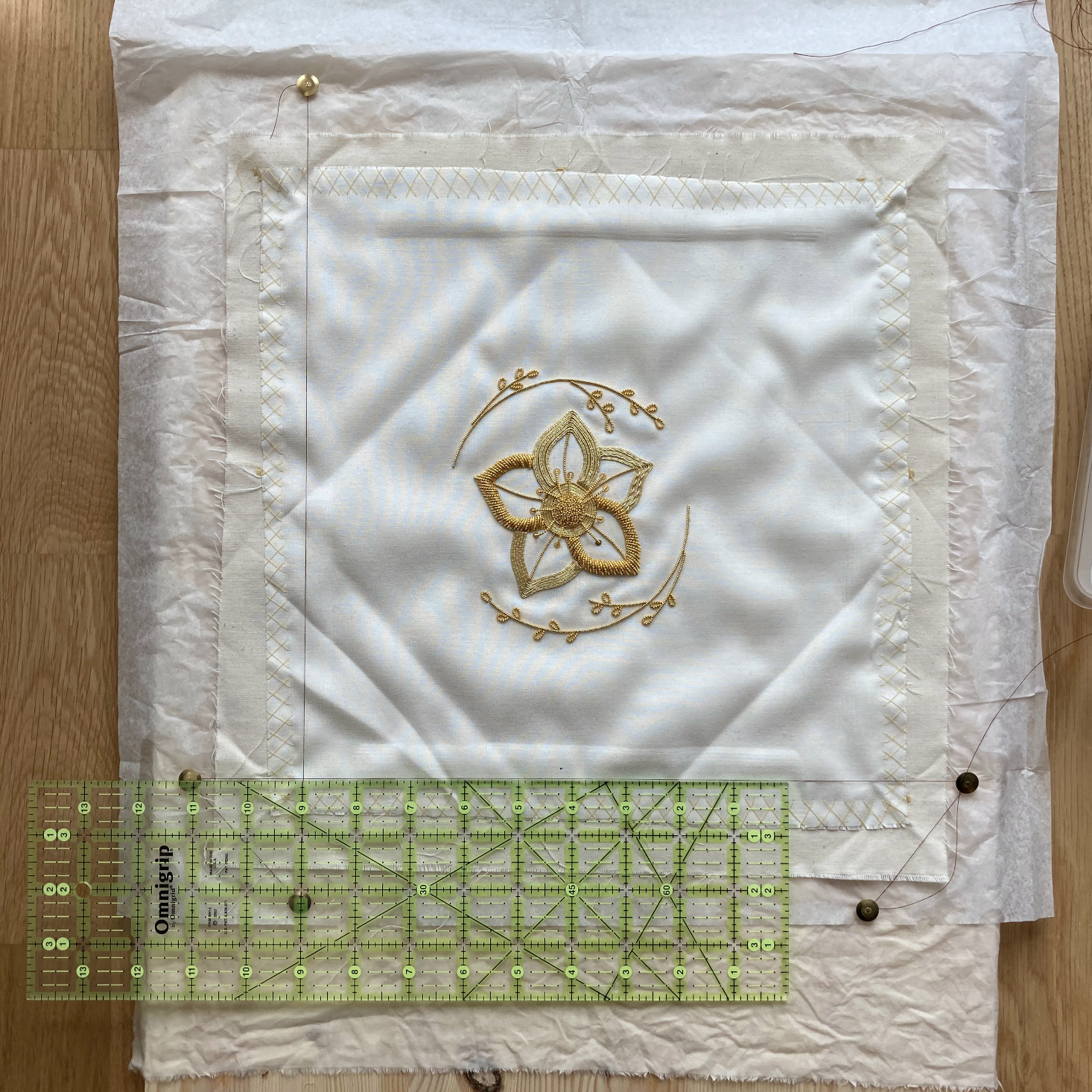 How to hold the ruler to square out the thread frame.